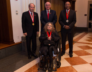 IU President Michael A. McRobbie, back center, joins medal honorees Gerald Bepko, left, David Wilkes, right, and Fedwa Malti-Douglas.
