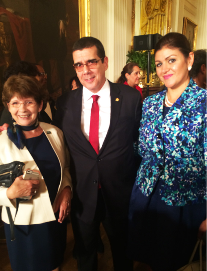 Dr. Dolores Henchy (left), Professor and Dean, Institutional Assessment and Academic Success Programs, and Cynthia Montalvo (right), Director, Financial Aid, talk at the White House reception with Jose Cabanas, the first Cuban ambassador to the United States in more than 50 years.