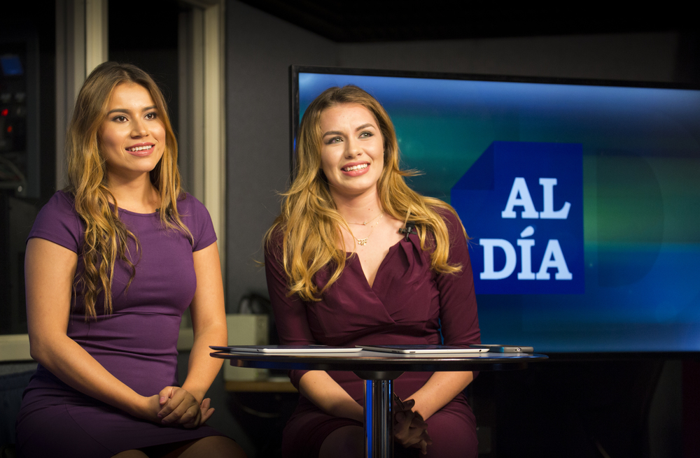 Student broadcasters Adeyling Fiallos and Marissa Plascencia film the show Al Día.