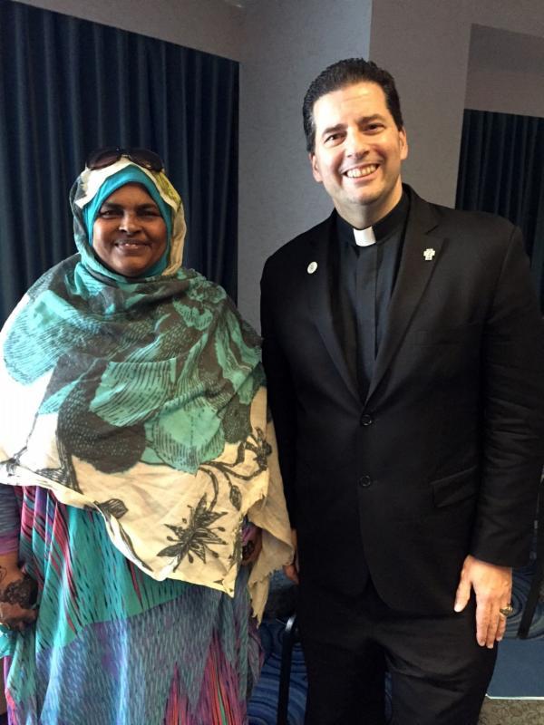 Hospitality & Tourism Training Institute graduate Anab Riyaleh with Rev. James J. Maher, C.M., president of Niagara University.