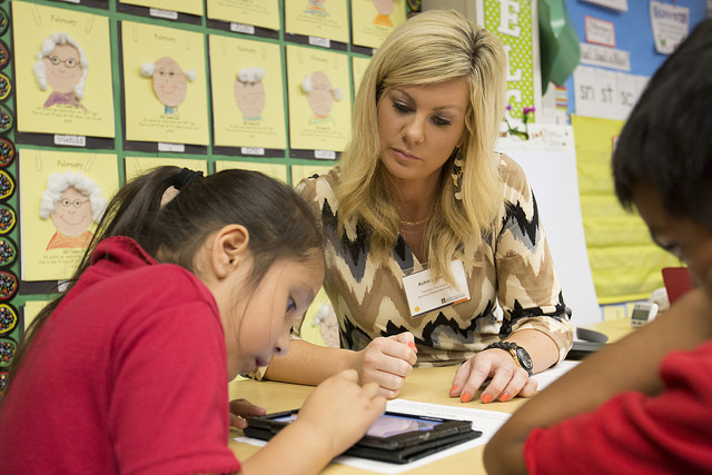 Rio Vista Elementary School teacher Ashley Naval works with first-grade student Arleny Moreno Garcia, where she uses an iPad as part of her lesson.