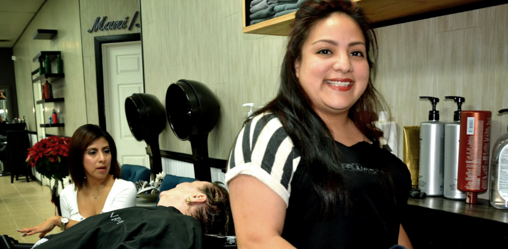 Leticia Cervantes (right), who holds a bachelor's degree in criminal justice, returned to college to study cosmetology. She graduated from Del Mar College in December.