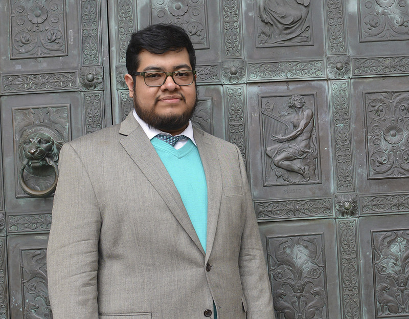 The Bronx Community College Class of 2016 Valedictorian Yardley Martinez, standing before BCC's architectural masterpiece, Gould Memorial Library