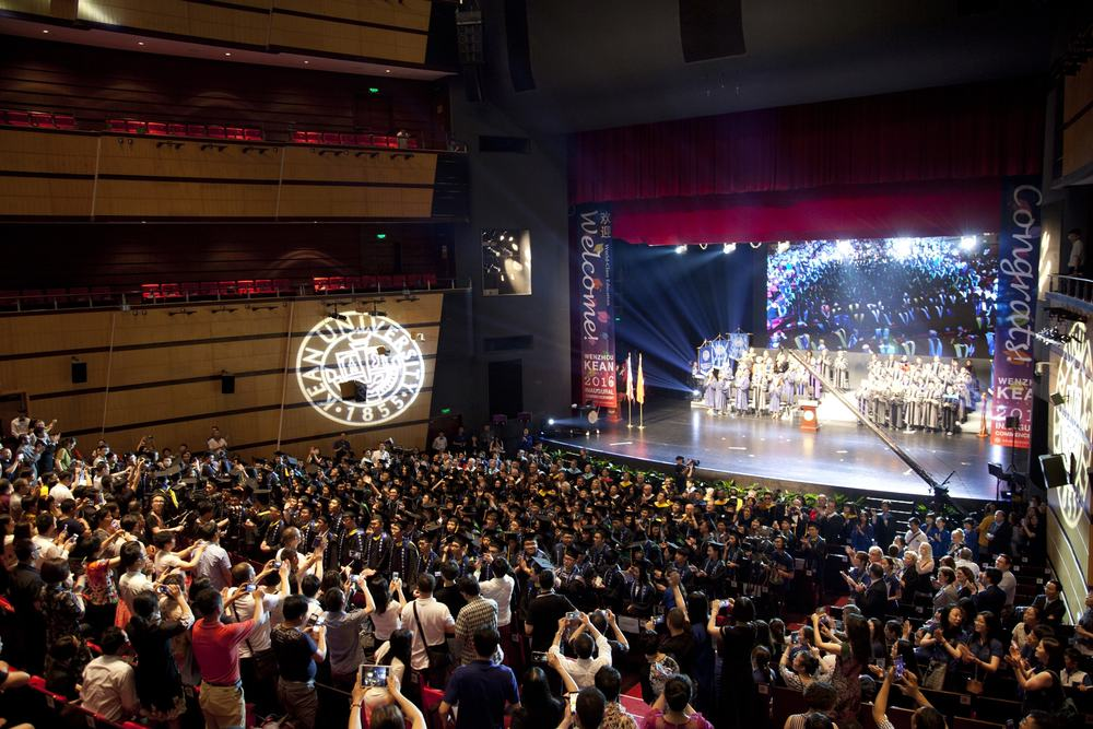 Parents and families of the inaugural graduating class at Wenzhou-Kean University in Wenzhou, China fill the Wenzhou Grand Theatre to watch students receive diplomas in an American-style commencement ceremony.