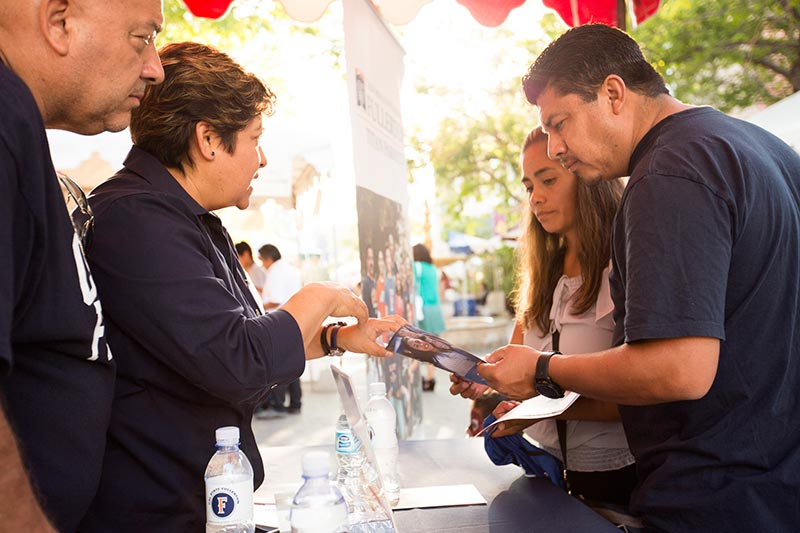 "Newcomers to Cal State Fullerton and their families will learn about the campus at the June 5 ""Celebración Familiar de 'Titans.'"""