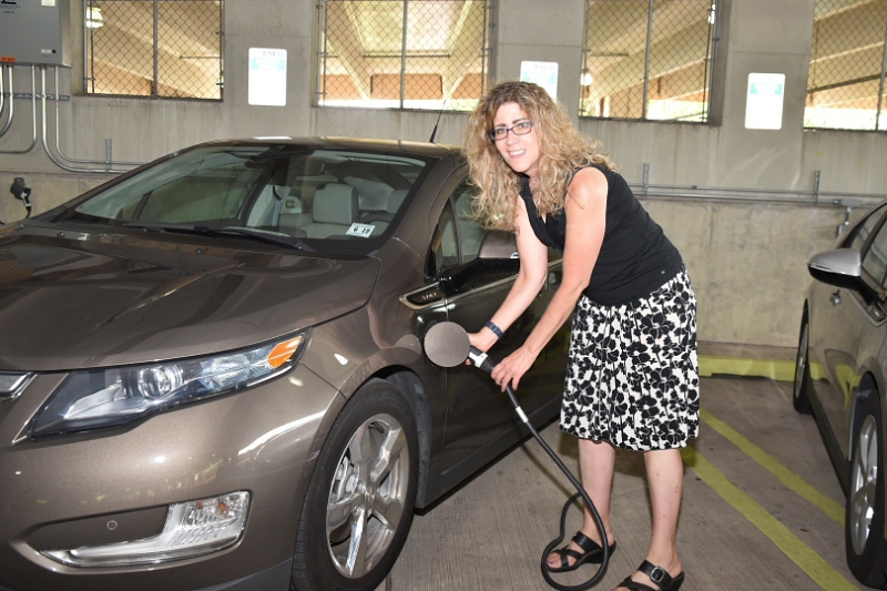 Lee Ann Riccardi, professor of art history and interim director of the college's Center for Global Engagement, plugs in her 2014 Chevy Volt. (PRNewsFoto/Public Service Electric and Gas)
