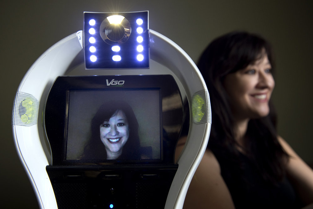 """Every year, large numbers of K-12 students are not able to go to school due to illness, which has negative academic, social and medical consequences,"" says UCI doctoral student Veronica Newhart, lead author of a study on the benefits of telepresence robots, such as the one shown. Steve Zylius / UCI"