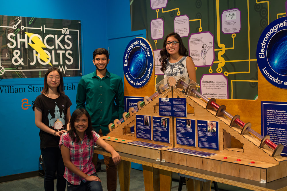 Rice University students, from left, Sammi Lu, Rachel Nguyen, Saad Yousaf and Karen Vasquez with the exhibit they designed and built for the Children's Museum of Houston to demonstrate the principles of electromagnetism. (Credit: Jeff Fitlow/Rice University)