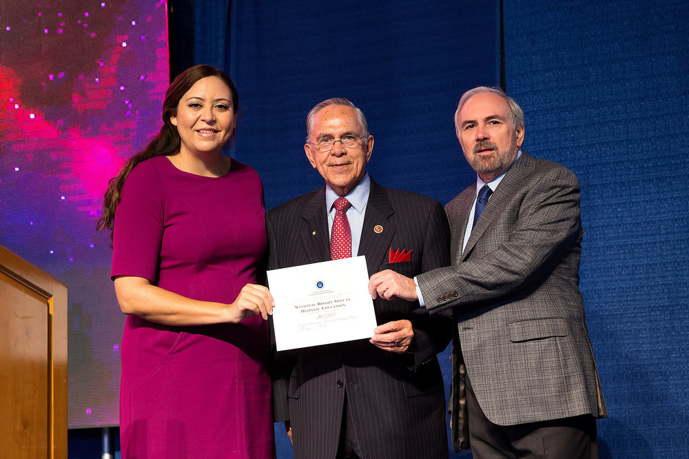 "Alejandra Ceja, executive director of the White House Initiative on Educational Excellence for Hispanics, presented U.S. Rep. Rubén Hinojosa (Texas District 15) and UTRGV President Guy Bailey with an award recognizing HESTEC as a ""National Bright Spot in Hispanic Education,"" during HESTEC Educator Day on Monday, Oct. 3, 2016, at the Fieldhouse on the Edinburg Campus."