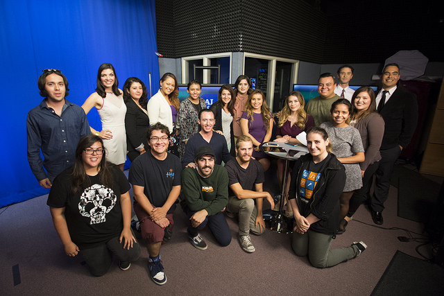 The cast and crew of Al Día gather for a group photo.