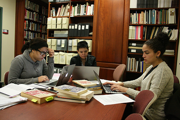 A group of LaGuardia Community College students studying at the LaGuardia and Wagner Archives.