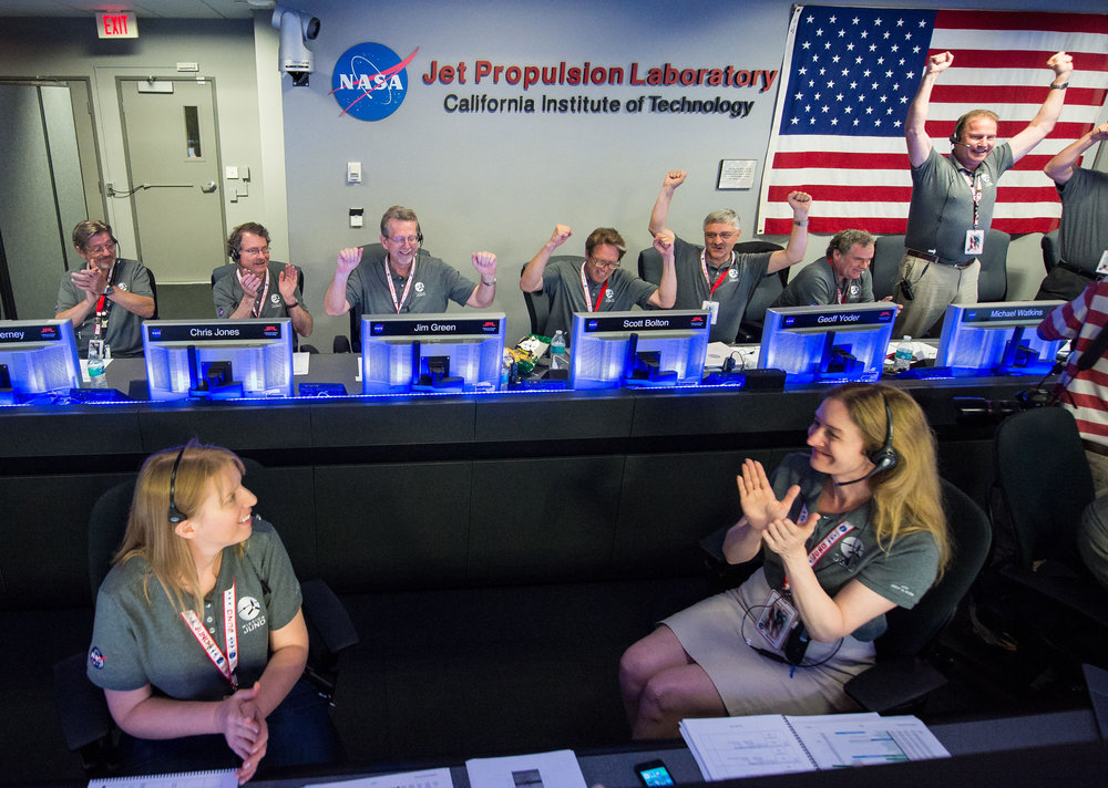 The Juno team celebrates after receiving confirmation from the spacecraft that it had successfully completed the engine burn and entered orbit of Jupiter, Monday, July 4, 2016 in mission control of the Space Flight Operations Facility at the Jet Propulsion Laboratory. the hispanic outlook magazine