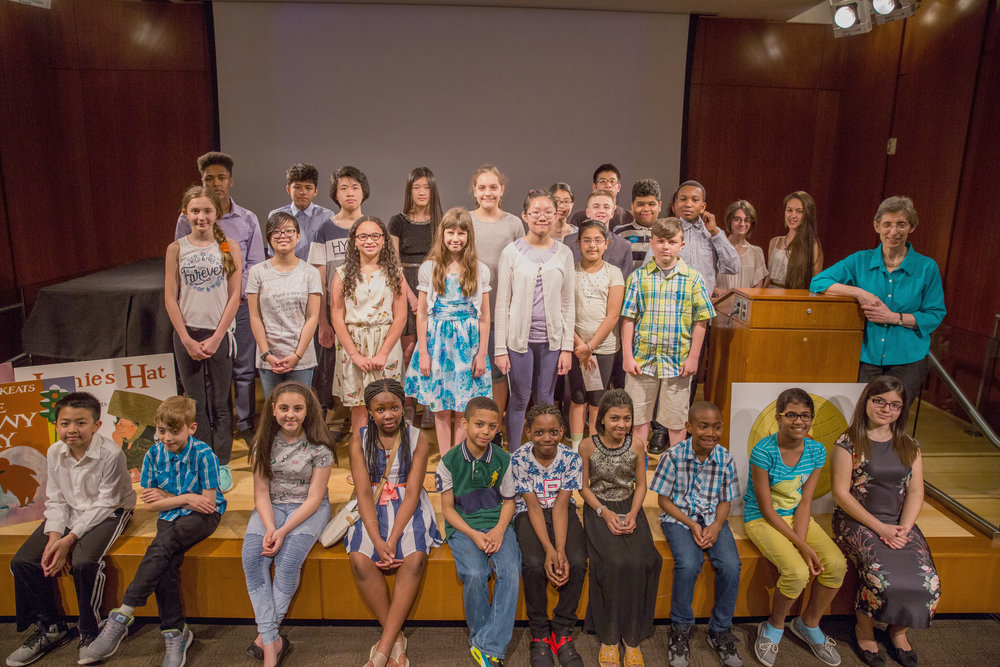 Winners of the 2017 EJK Bookmaking Competition and honorable mentions gathered for a group shot with Deborah Pope (right, by podium), executive director of the Ezra Jack Keats Foundation.