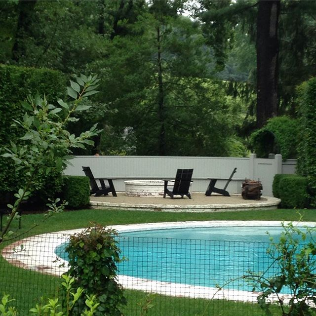 Pool with Exedra Fire Circle in CT #bfivestudio