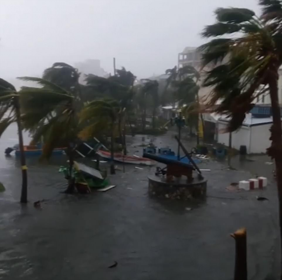 43F8696E00000578-4857842-Hotels_were_flooded_and_cars_submerged_as_floods_hit_coastal_are-a-17_1504749807965.jpg