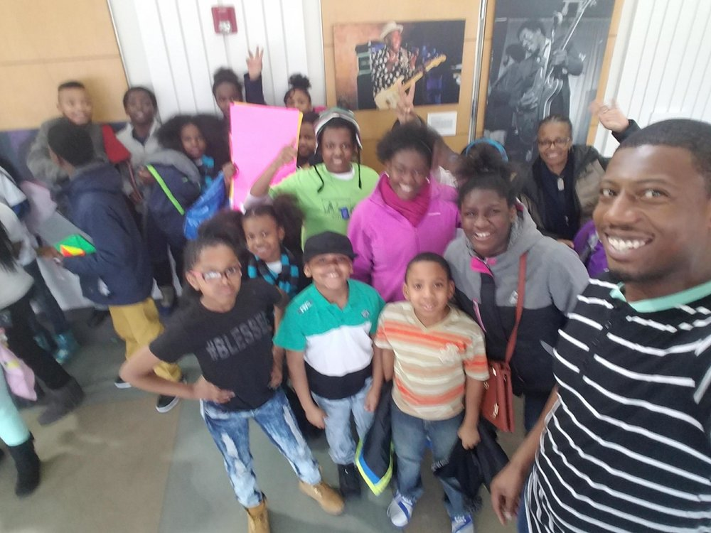 "Students from Chalmers, Dvorak, and DePriest Elementary Schools with instructor Rapheal Arteberry and board member Jackie Ingram at the ""Take Action!"" event in Homan Square on February 11, 2017"