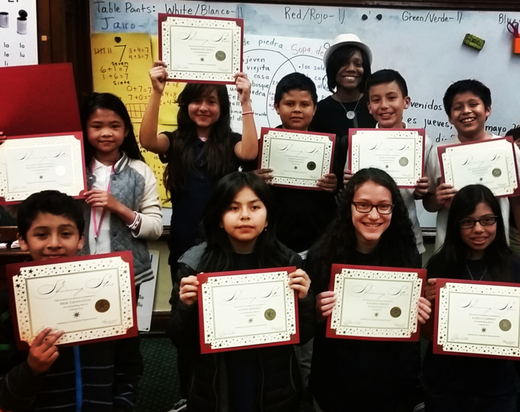 Newton Bateman Elementary School students proudly display their diplomas with instructor Carolyn Hodrick, May 2015