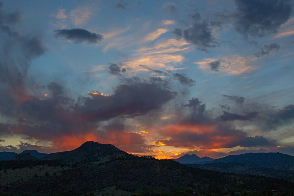 The view from just east of Lyons: Coffin Top Mountain in the distance at left, Indian Lookout Mountain just left of center, and Mt. Meeker and Longs Peak at center right - and a gorgeous Colorado sunset.   You can find more of my landscape and nature photography here .