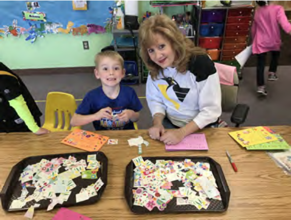 Mrs. Terri and Brody are working hard on decorating Mother's Day cards.
