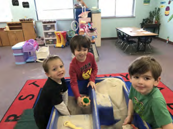 AJ, Link and Tommy having fun in the sand table.