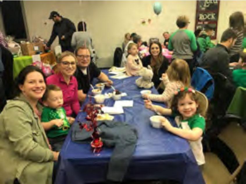 Lydia and her family enjoying one of Pastor's famous ice cream sundaes.
