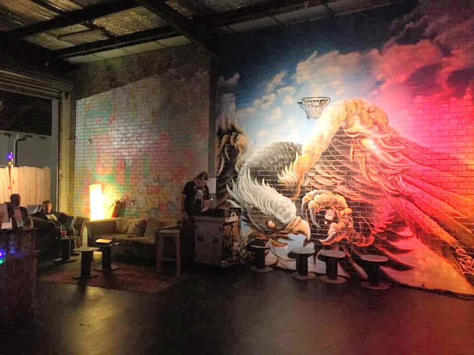The Garage murals come to life at night