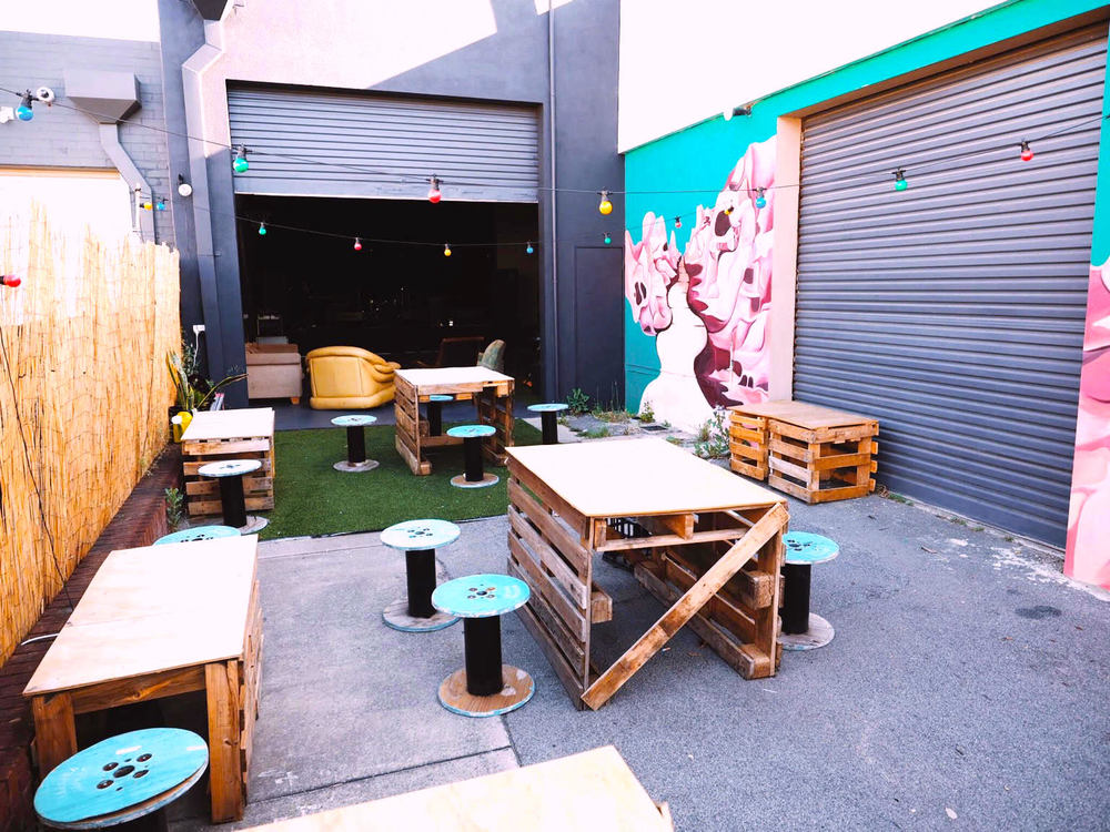 A courtyard area with urban furniture, BBQ and firepit