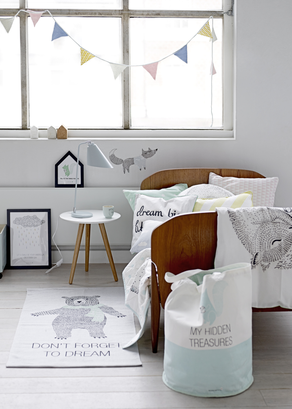 I spy our knitted bunting, fox wall sticker, toy bag, most adorable bear rug and framed rain print. Come check out everything you need to create the most precious baby or kids room
