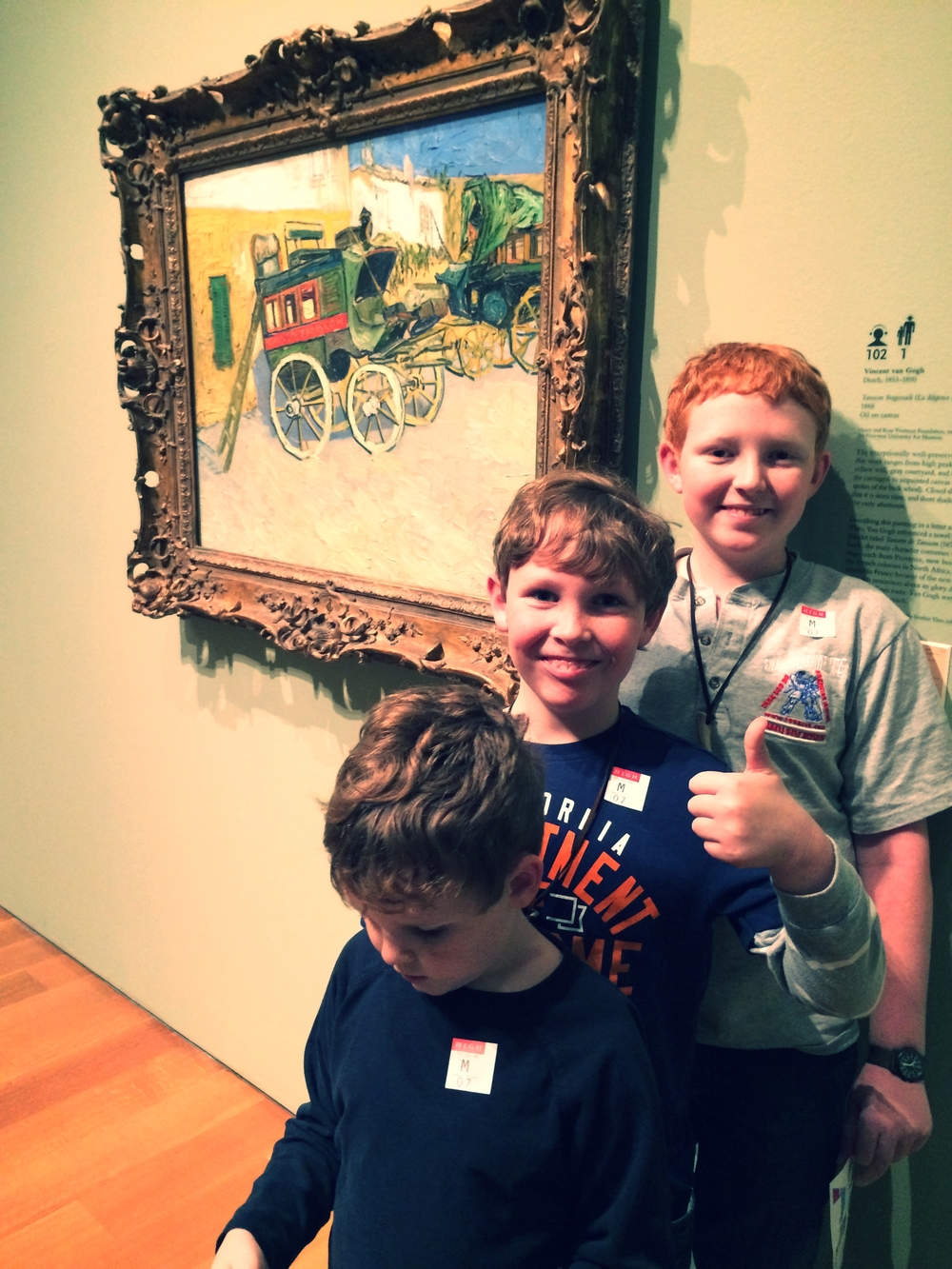 My boys in front of Van Gogh's Tarascon Stage Coach