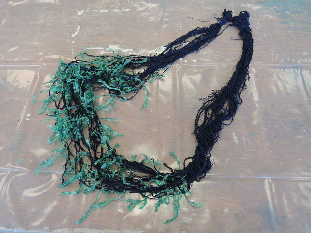 Warp dyed in indigo with ikat resist.