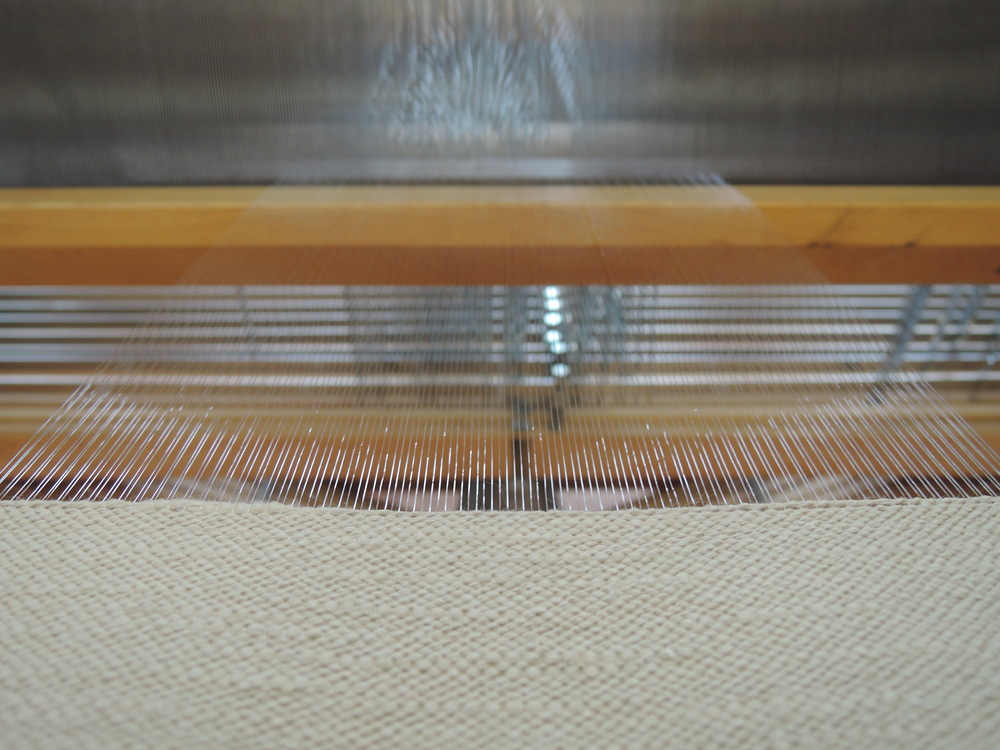 Weaving on the beautiful, clear warp.