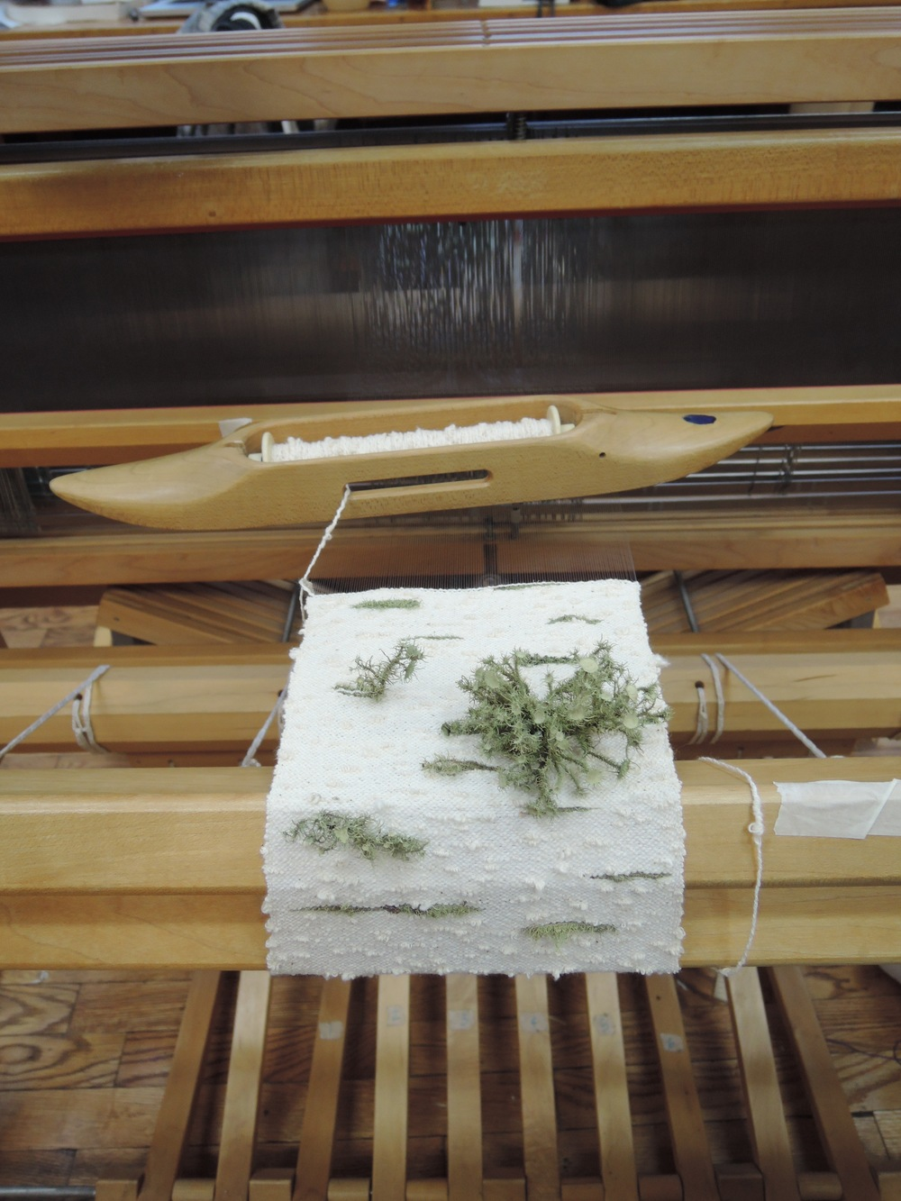 Carefully weaving with lichen and the end of my favorite discontinued yarn.