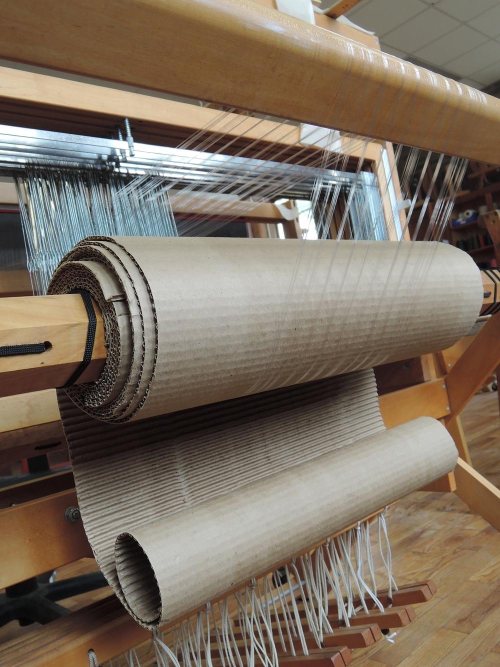 Warp on the loom.