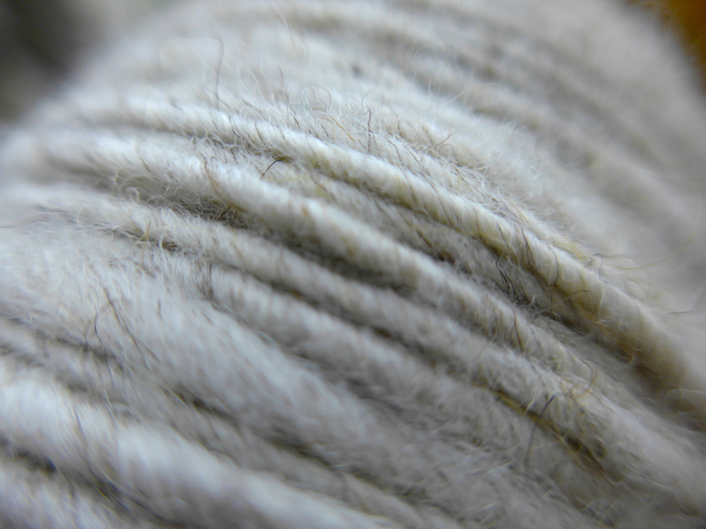 Greta's fleece is one of my absolute favorites to spin because the yarn shows off all her beautiful, subtle coloring.  Greta is a spunky sheep who apparently loves to jump really high, hang out with her family, and visit people.  I can't wait to weave this yarn.