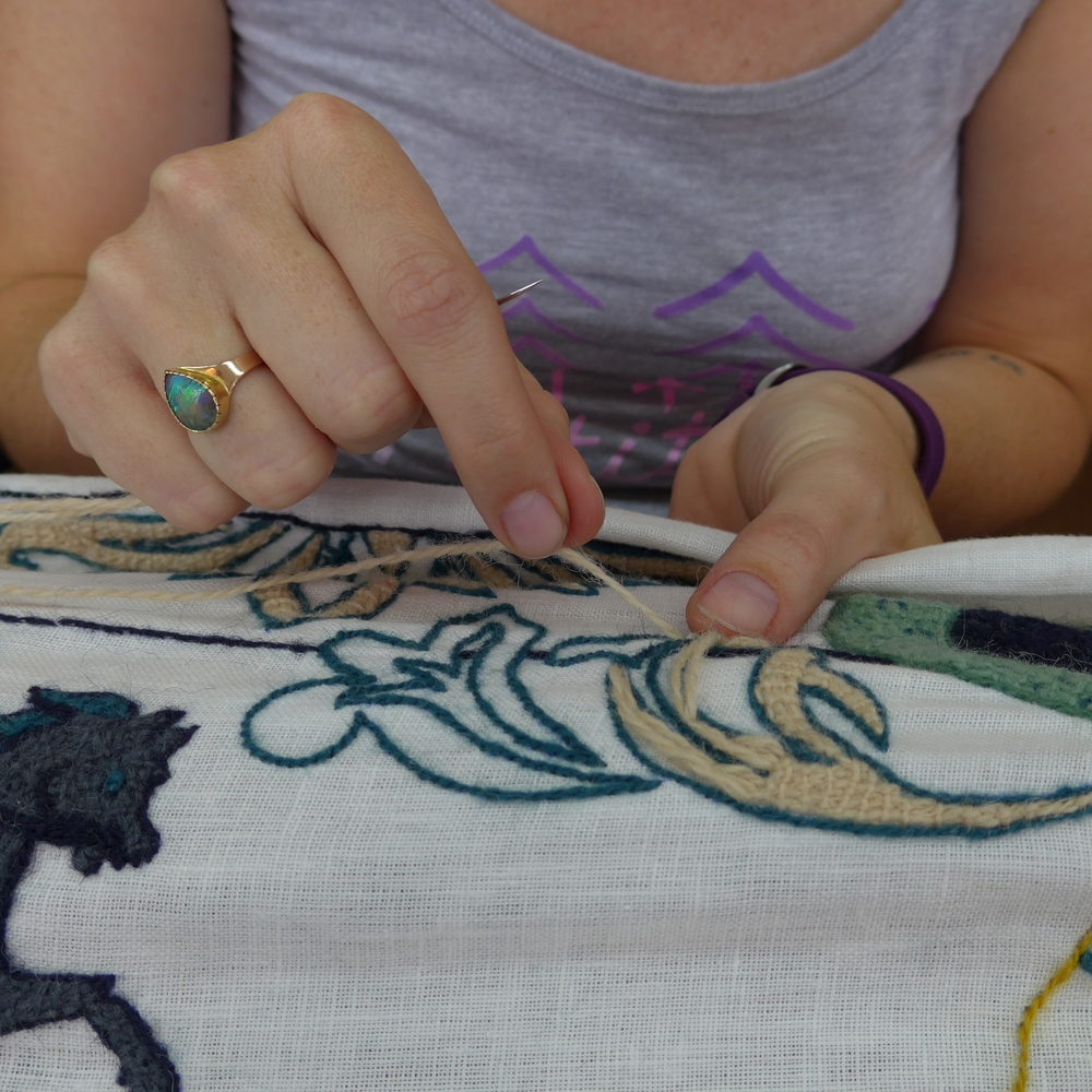 A friend of the current coordinator visited and worked on the tapestry.