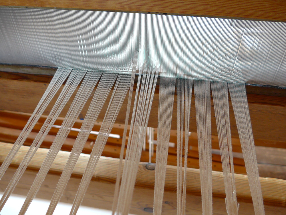 Oh no!  I skipped four warp threads right in the middle.  No worries.  I made them each their own personalized string heddle.