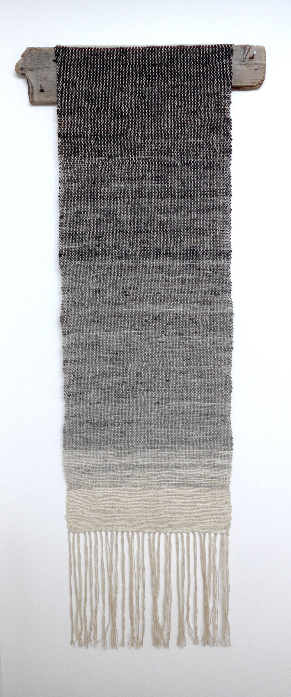 Icelandic Fog, Kim Mirus, 2015  I used Icelandic wool to carefully card and handspin this gradient into the yarn.  It was then woven with carefully sourced wool from a small farm of happy sheep, and hung from a piece of driftwood that arrived as I finished the piece.  This piece serves as an extensive study that will inform my next pieces woven from my handspun yarn.