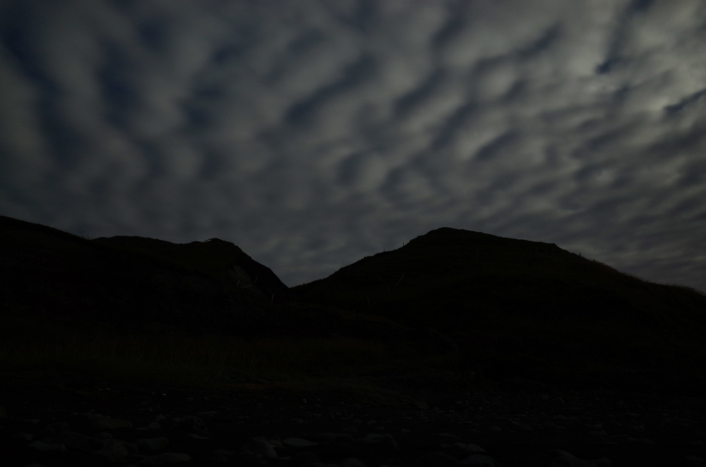 Since the aurora were barely discernible, I focused my attention to the crazy clouds illuminated by the moon.