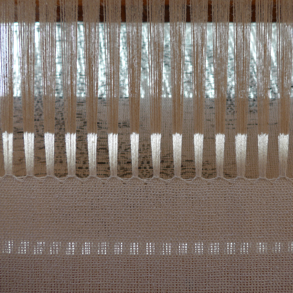 Sunlight and shadows on one of my weavings on the loom.