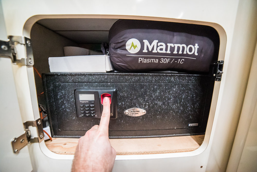Security, baby. This is the Viking Safe VS-38BL, with fingerprint scanner. It took hours to bolt it in, but it was worth the peace of mind. The fingerprint makes it much easier to unlock in the dark. The van also has a high-end alarm system from Viper.