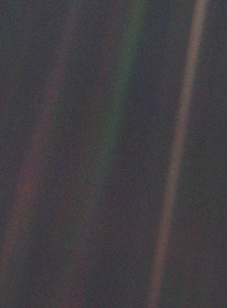 """…a mote of dust suspended in a sunbeam…""   Pale Blue Dot"" by Voyager 1 –   http://1.usa.gov/1tfuim2  . Licensed under Public domain via Wikimedia Commons –   http://bit.ly/1q04WE4"