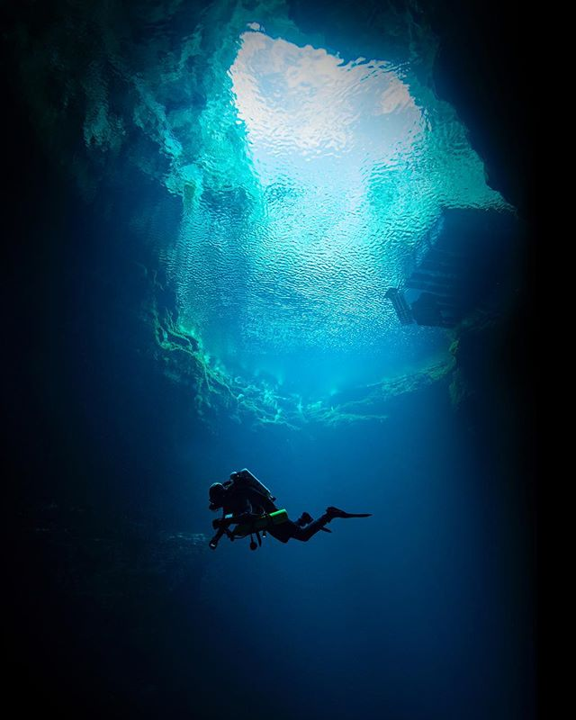 Diver swims into the black in Mount Gambier, #southaustralia #australia #diving #scuba #cave #underwaterphotography