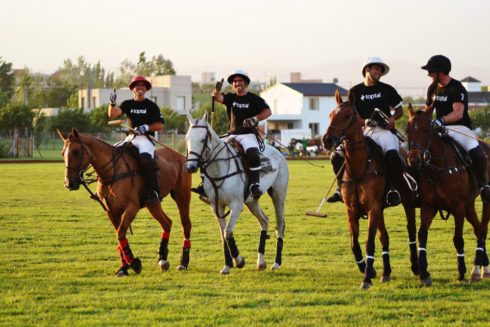 Playing polo with Toptal developers in Argentina. Total cost for sponsorship: 400 pesos (~$40) for t-shirts.