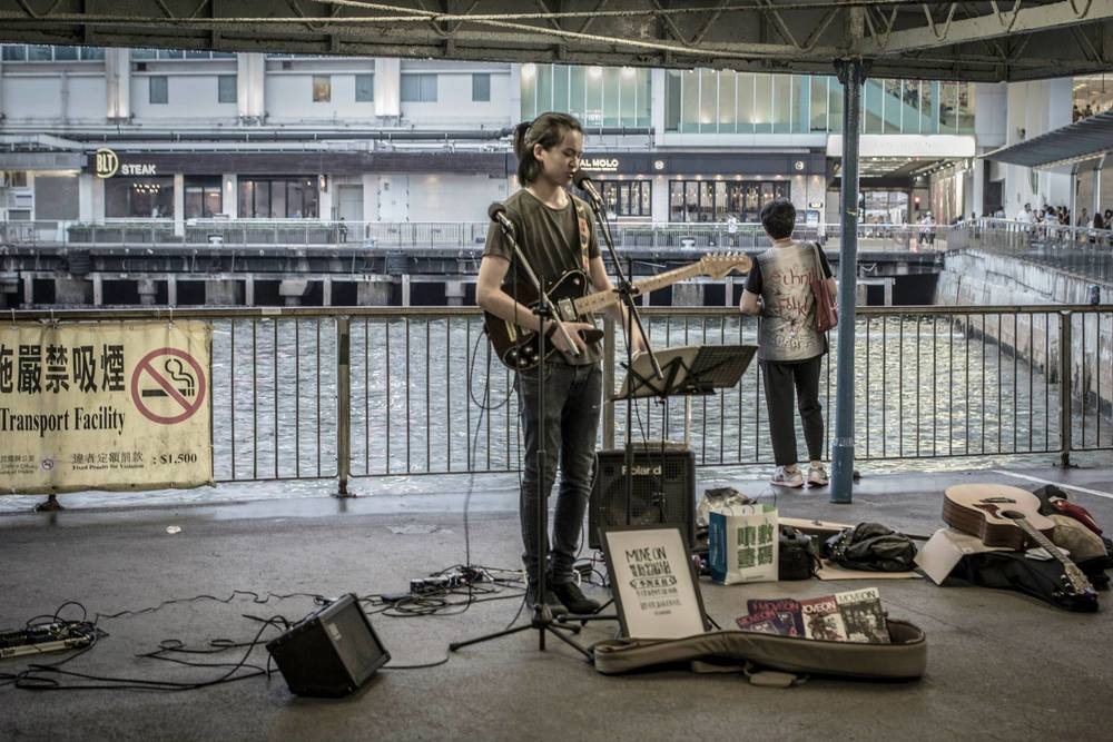 Busking at Star Ferry Pier