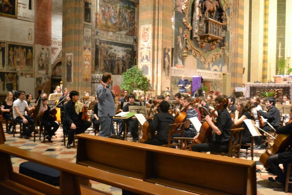 Rehearsing with the Durham University Symphony Orchestra at the Santa Anastasia Church in Verona, Italy