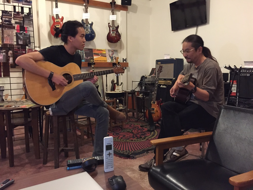 Jamming with a local guitar shop owner after a day of filming in Japan