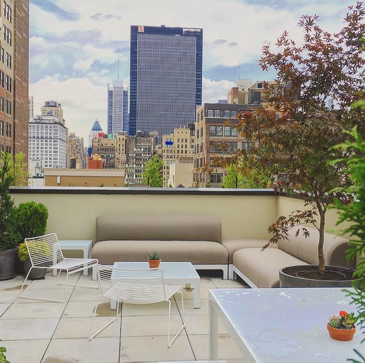 A sunny rooftop overlooking New York's midtown.
