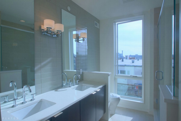 Included in the owner's suite is an en suite bathroom, with finishes much like these shown in the picture.