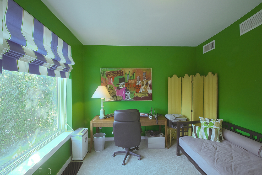 The second bedroom, with its picture window, can be used as an office as well.