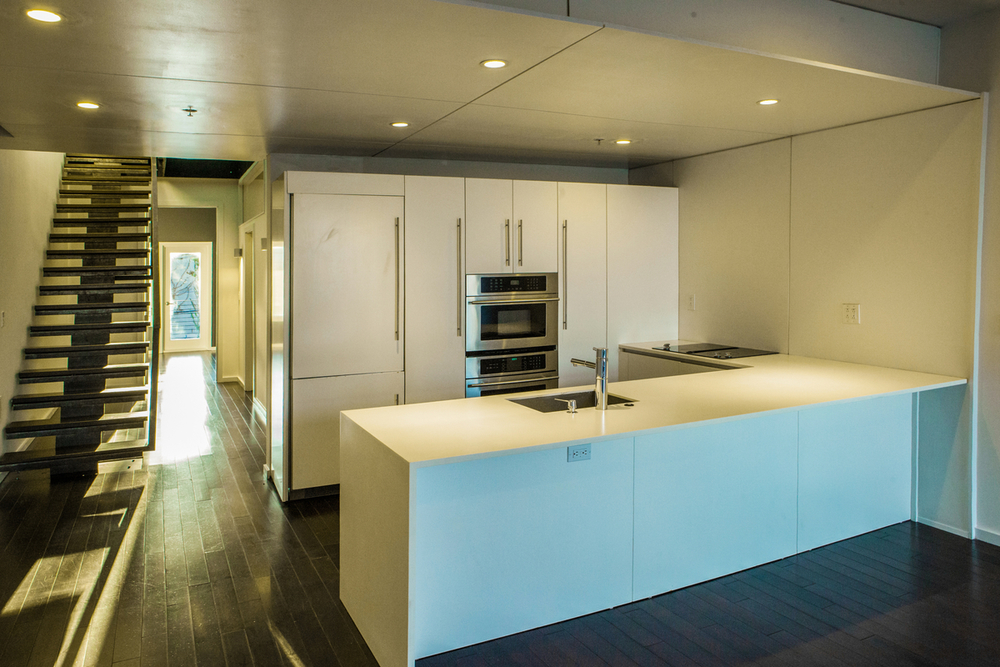 The kitchen is designed with Bazzeo by NY Loft, some Jenn Air appliances, a Liebherr refrigerator and Fagor dishwasher.